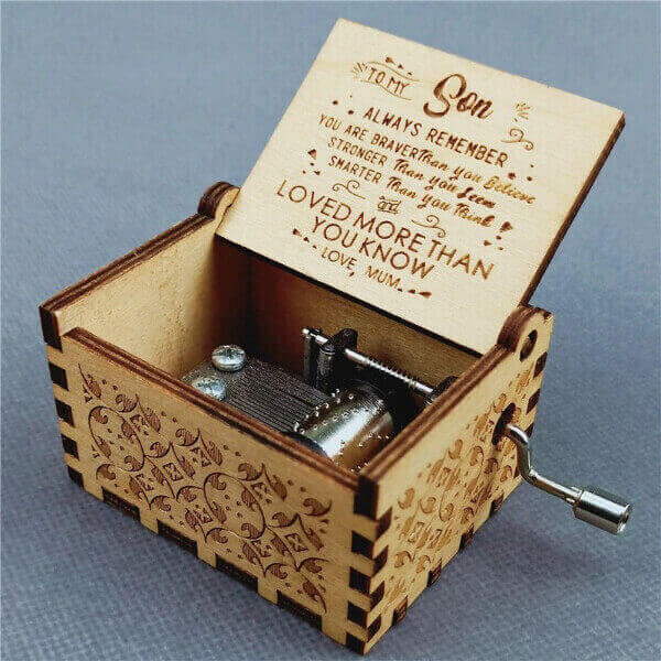 ENGRAVED WOODEN MUSIC BOX